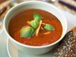 Creamed tomato soup with carrots and basil
