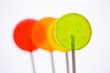 Four coloured lollipops