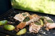 Grilled salmon fillets with lemon wedges