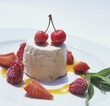 Nut semifreddo with berries and cherries