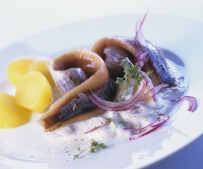 Matjes herrings with cream sauce and boiled potatoes