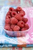 Fresh raspberries in a plastic punnet