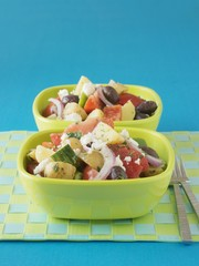 Greek salad with new potatoes