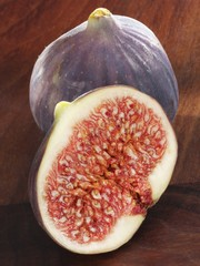 Half a fig in front of a whole fig