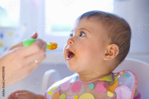 Baby being fed baby food