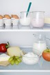 A fridge filled with dairy products, eggs, fruit and vegetables