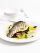 Grilled sea bass on spinach with oranges
