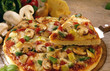 Pizza with mushrooms, peppers, onions and cheese