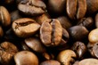 Close-up of coffee beans, filling the picture