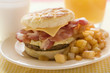 Cheeseburger with scrambled egg, bacon & fried potatoes