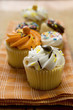 An assortment of decorated muffins