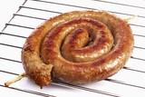 Coiled sausage on oven rack