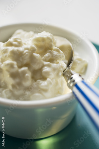 Cottage cheese in a small bowl with spoon
