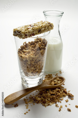 Crunchy muesli, muesli bar and carafe of milk