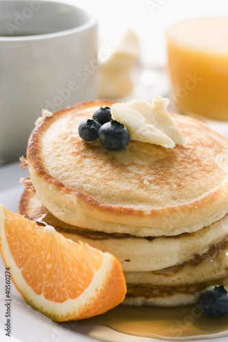 Pancakes with butter and fruit for breakfast