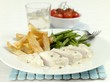 Chicken breast with pepper sauce, chips and beans