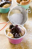 Individual bread puddings with cherries & icing sugar