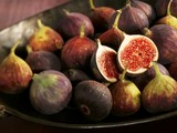 A bowl of whole and halved figs