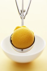 Mango sorbet in an ice cream scoop