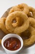 Squid rings in paper dish with dip