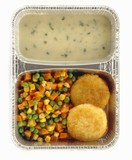 Coley fish cakes with dill sauce and vegetables