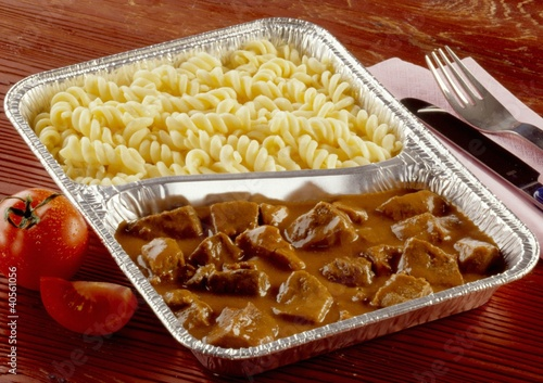 Beef goulash and pasta in aluminium dish