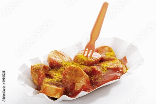 A currywurst (sausage with ketchup & curry powder) in paper dish