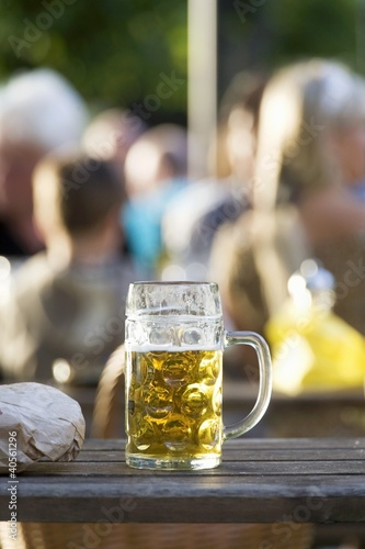 A litre of beer (partly drunk) standing on a table