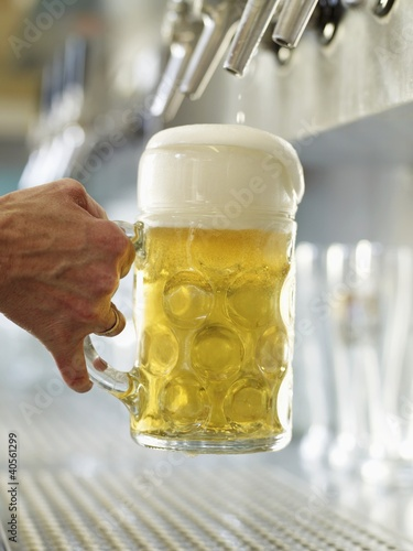 Pouring a litre of draught beer