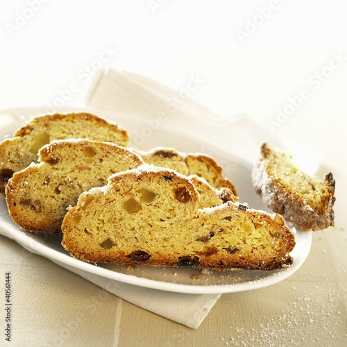 Three slices of Christmas stollen on a platter