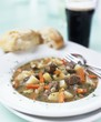 Irish stew with bread and a glass of Guinness