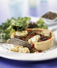 Mediterranean vegetable tart with mozzarella & salad leaves