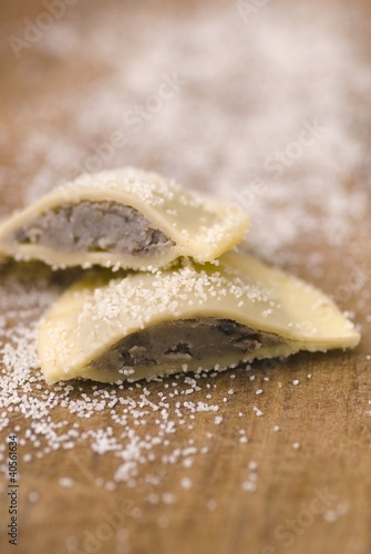 A truffle ravioli, halved, sprinkled with salt