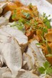 Turkey breast with carrots and parsley, close-up