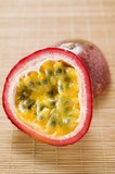 Purple granadilla (passion fruit), halved