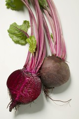 Beetroot with leaves, one halved, close-up