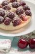 Cherry tart with icing sugar