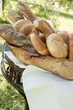 Assorted bread, bread rolls & croissants in bread basket
