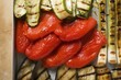 Grilled vegetables in roasting tin (close-up)