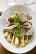 Turkey with herb sauce on root vegetables