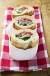 Sandwich rolls filled with pork and peppers