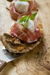 Crostini with Parma ham, mozzarella and basil