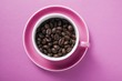 Coffee beans in pink coffee cup
