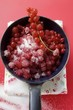 Sugared redcurrants in a pan
