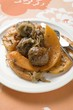 Meatballs with roasted pumpkin wedges on plate