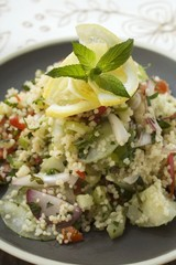 Couscous salad with vegetables, lemon and mint