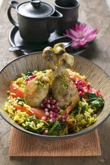 Chicken legs with saffron rice & pomegranate seeds (Asia)