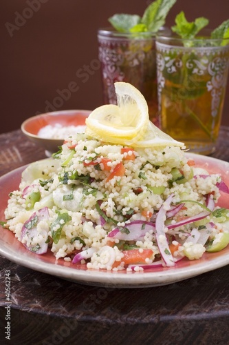 Couscous salad with vegetables, two glasses of peppermint tea