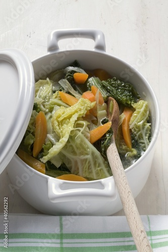 Savoy and carrot stew in pot