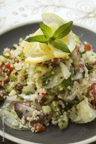 Couscous salad with vegetables, lemon and mint